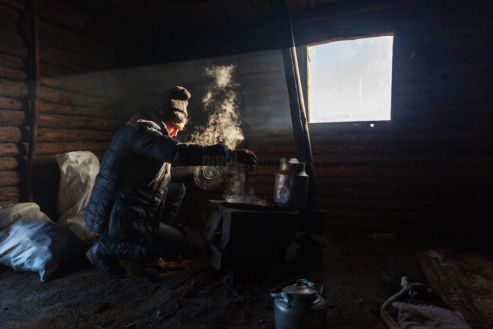 Nurbol Brewing Tea in the Overnight Herders' Hut