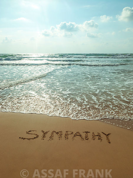 Word Sympathy written in sand on the beach