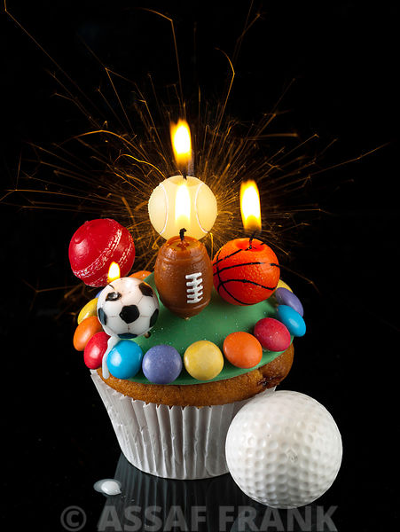 Cupcake with sports balls shaped candles