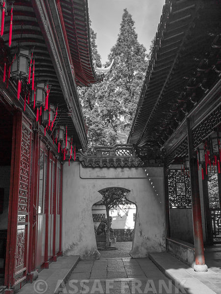 A corridor wiht a vase gate. A traditional scene at Yu Garden Shanghai.