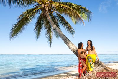 Local polynesian girls on the beach, Rarotonga, Cook Islands
