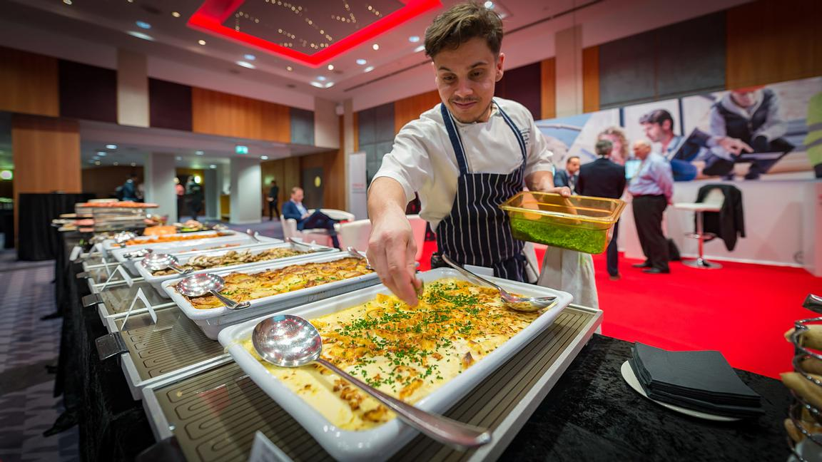 Chef Re-filling Food Buffet at Corporate Event