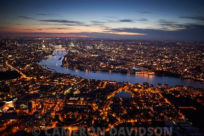 Aerial of the Thames River, London, in the early evening.