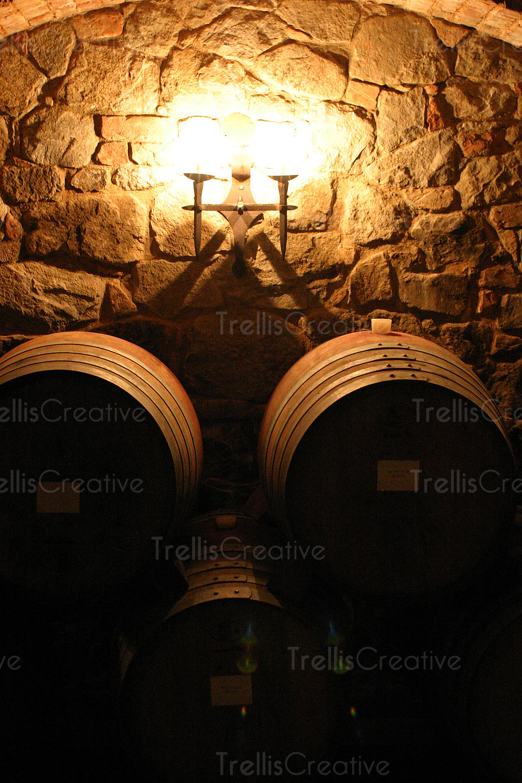 Oak wine barrels stacked up in an old winery cave