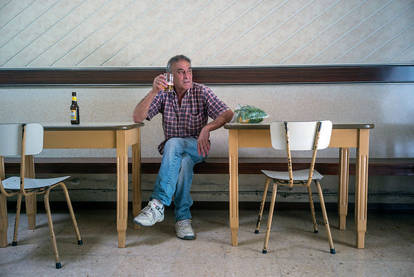 A Man Drinks A Beer In The Coney Island Bar