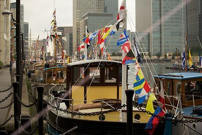 Bunting on This Dunkirk Little Ship with the Towers of Canary Wharf in the Background