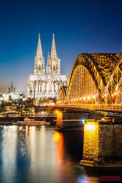 Bridge and cathedral at night, Cologne, Germany