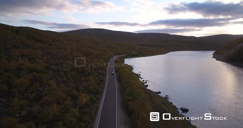 Autumn Color Road, Aerial View Following a Car Driving on Road 970 the Tenontie, Near Tenojoki River, at the Border of Norway...