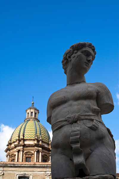 Italy - Palermo - A statue in Piazza Bellini with the dome of San Giuseppe dei Teatini
