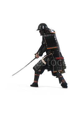 A Samurai warrior with his sword out - shot from low-level.