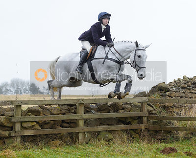 Charlotte Bell jumping a wall at Goadby Hall