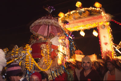 India - Allahbad - A leader of an Akhara, a Saddhu regiment is paraded to the ganges on a palanquin held shoulder high at the...