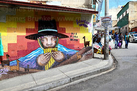Mural of indigenous man playing panpipes and Mar para Bolivia / Sea for Bolivia slogan, La Paz, Bolivia