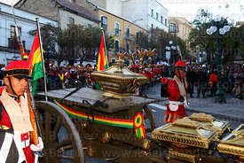 Members of the Los Colorados presidential regiment accompany caskets with remains of members of the Junta Tuitiva during the Desfile de Teas / Torch Parade to commemorate the July 16th 1809 uprising, La Paz, Bolivia