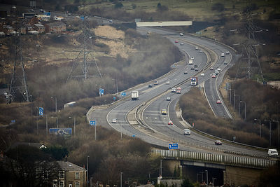 The M66 motorway winds past  Blackburn, Lancashire, England,UK. heading towards Burnley.