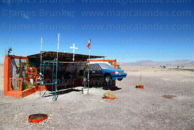 Roadside shrine (called animita de carretera in Chile) to traffic accident victim, near Calama, Region II, Chile