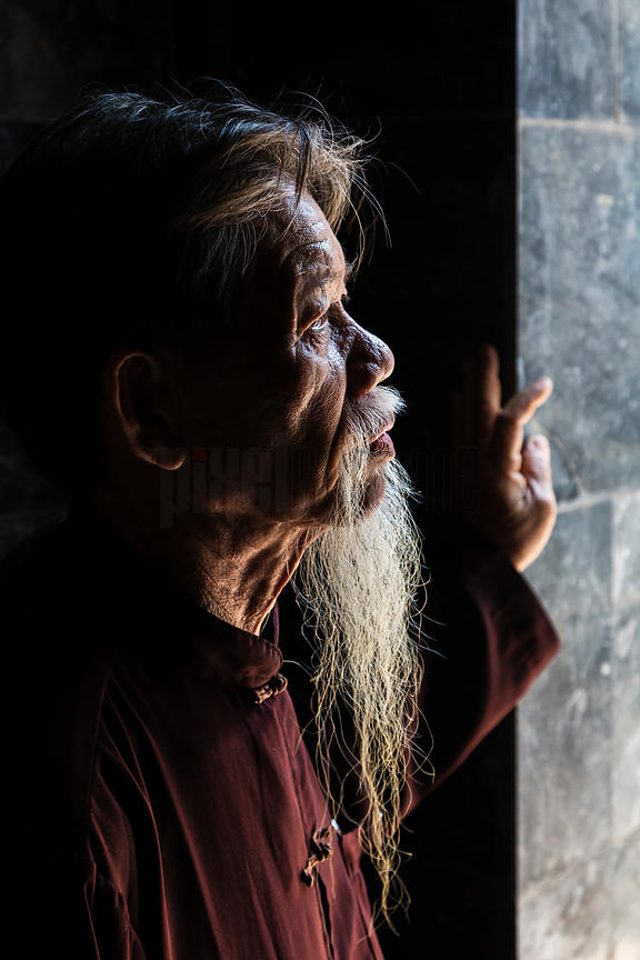 Portrait of Mr Tim a Buddhist Temple Caretaker