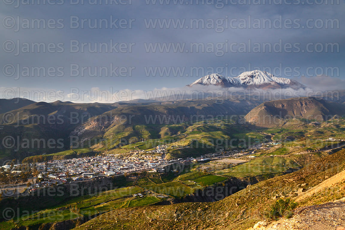Aerial view of Putre with Nevados de Putre / Taapaca volcano in background, Region XV, Chile