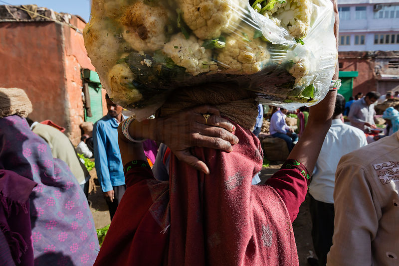Woman Carrying a Load of Cauliflowers