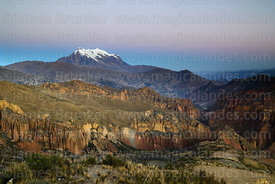 Rock formations above Palca Canyon and Mt Illimani at twilight, Cordillera Real, Bolivia