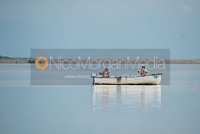 Fishermen fly fishing from a boat on Rutland Water