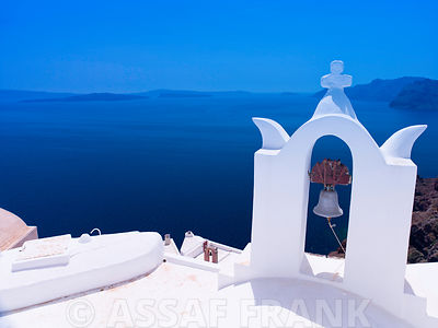 Greece, Cyclades. Santorini Island, Church bell with mountain in background