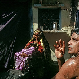 Sravan Kumar washes before a performance. Sravan, a puppeteer and singer has lived in Kathputli Colony for 30 years