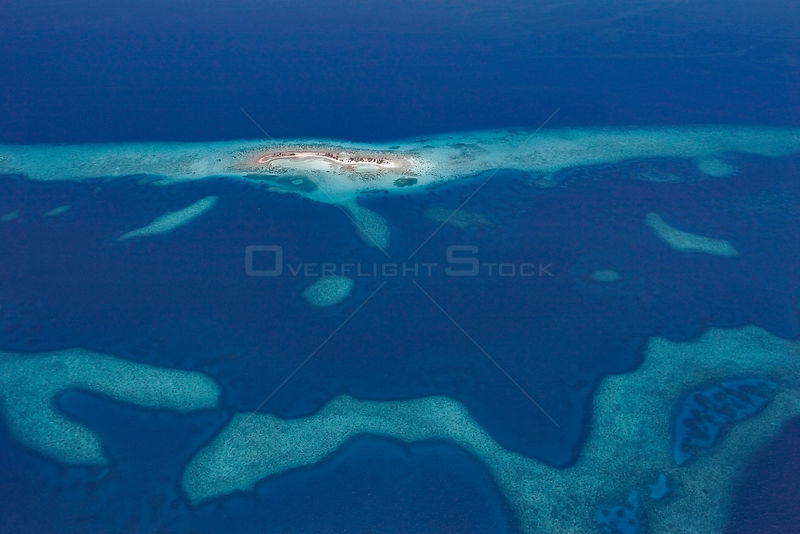 Aerial view of Laughing Bird Caye, a narrow sand caye (small island), in Laughing Bird Caye National Park. Belize Barrier Ree...