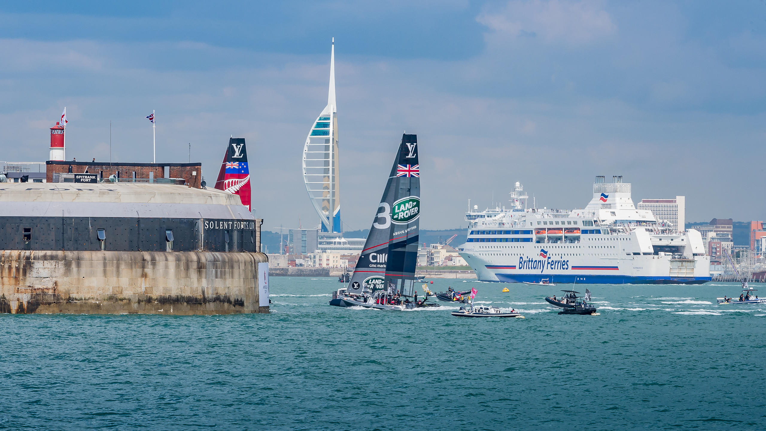 America's Cup 2016 Yachts in the Solent, with Spitbank Fort, Spinnaker Tower and a Brittany Ferry