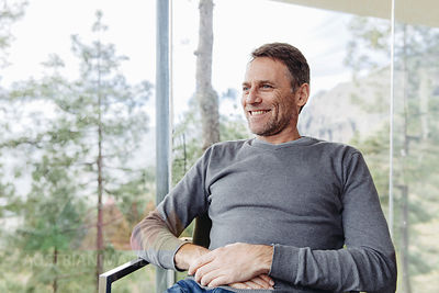 Smiling mature man in front of nature