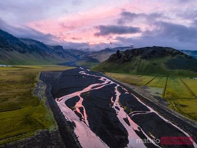 Aerial drone view of river and mountain at sunset, Iceland