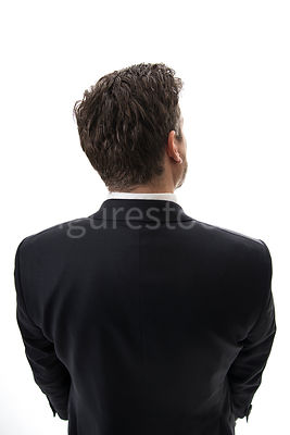 A mystery man in a suit, from behind – shot from above.