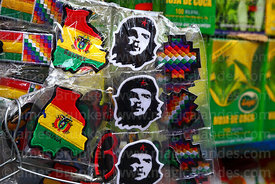 Embroidered badges of Che Guevara and Bolivian flag in shape of the country in tourist market, La Paz, Bolivia