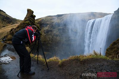 Photographer at Skogafoss waterfall Iceland