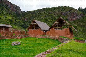 Restored Inca buildings and plaza in Huchuy Qosqo site, Cusco Region, Peru