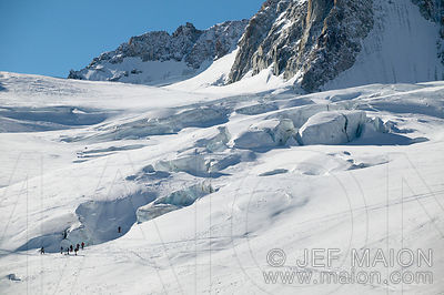 Skiers play in glacier crevasses