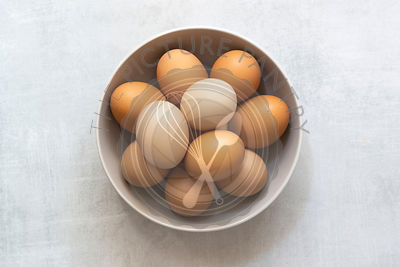 A bowl of brown and white eggs.