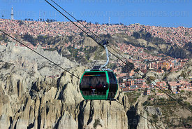 Green Line cable car gondola and earth / rock formations, El Alto in background, La Paz, Bolivia