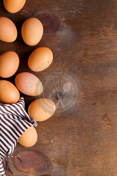 9 Eggs on brown Background