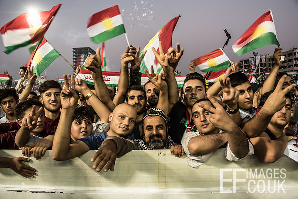 Attendees at the final pro Kurdish Independence Referendum rally, held at the Franso Hariri Stadium in Erbil, wave flags and ...