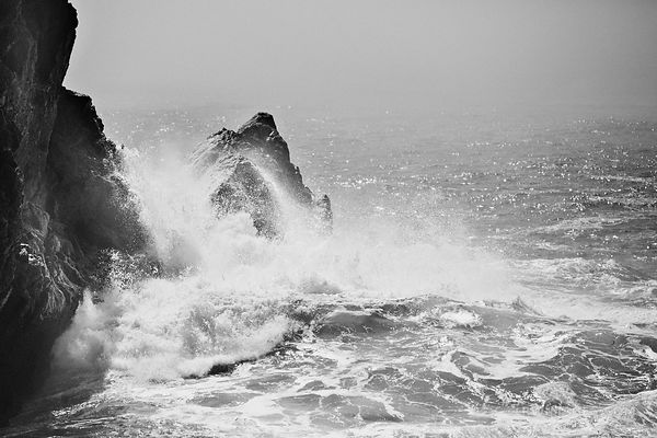 WAVES POUNDING THE ROCKY SHORE OF PARTINGTON COVE BIG SUR CALIFORNIA BLACK AND WHITE