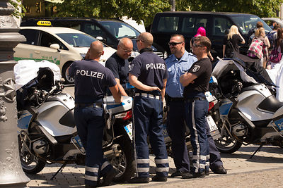 Group of German Motorcycle Policemen ralaxing on duty by The Brandenburg Gate