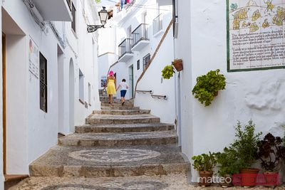 Tourists in the streets of a pueblo blanco, Andalusia, Spain