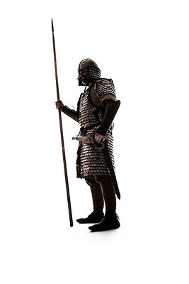 A semi-silhouette of a wealthy Viking in armour – shot from low level.