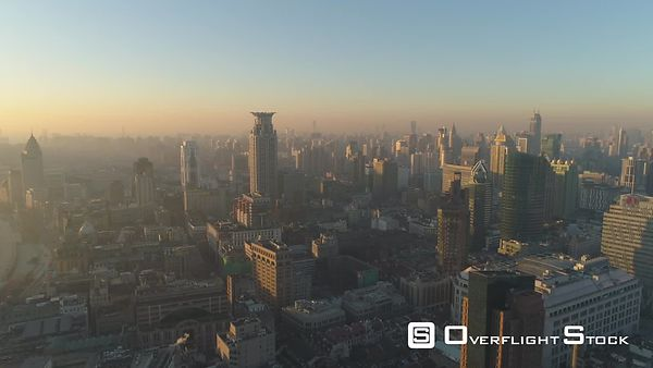Shanghai Skyline in the Morning Haze. China. Aerial View. Drone is Flying Backward. Establishing Shot.