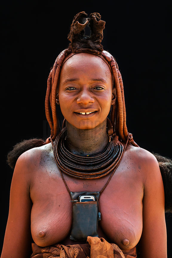 Porttrait of a Himba Woman with a Cell Phone around her Neck