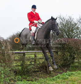 Ashley Bealby jumping near the new Jubilee Covert - Cottesmore Hunt at Deane Bank Farm 4/12/12