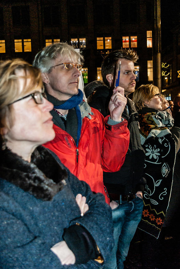 Amsterdam, Netherlands 2015-01-08: Man holding up a pen as a symbol of freedom of speech during the demonstration on the Dam