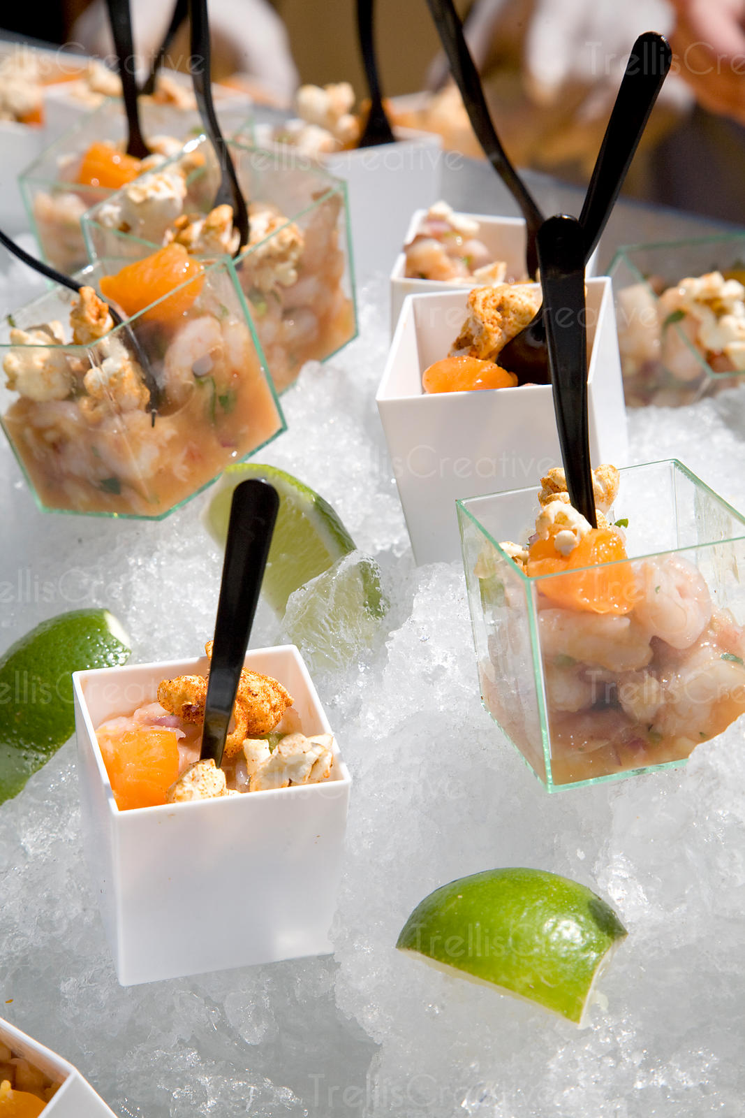 Small dishes of shrimp ceviche on a bed of ice
