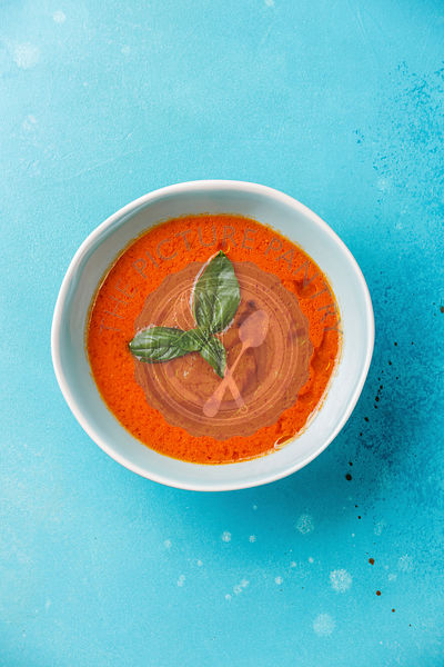 Gazpacho Tomato summer soup on blue background